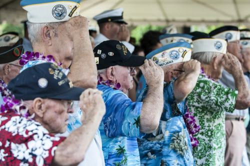 Pearl Harbor survivors salute.