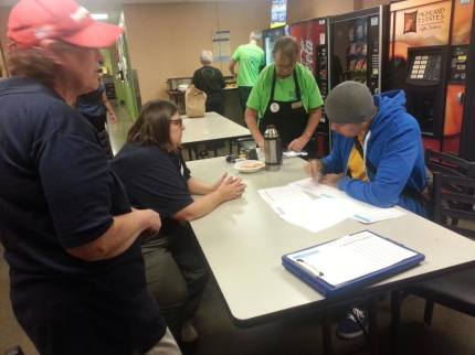 Workers at the Everett Fred Meyer sign up for picket line shifts.  Photo: 2013 Grocery Bargaining  Facebook page