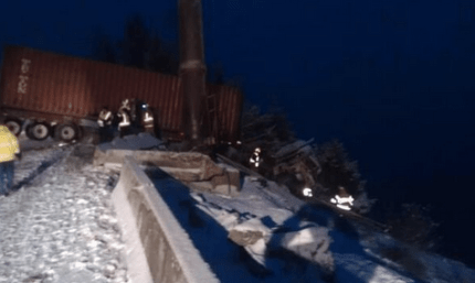 Semi truck hanging of I-90 embankment, 12/12/13, near Snoqualmie Pass