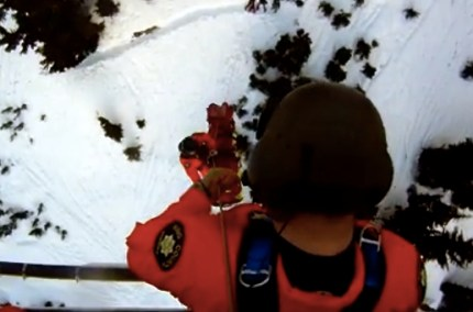 Search and Rescue crews, Guardian 2, hoist injured skier from Snow Lake, 1/25/14.  Photo: Screenshot KCSO YouTube video.
