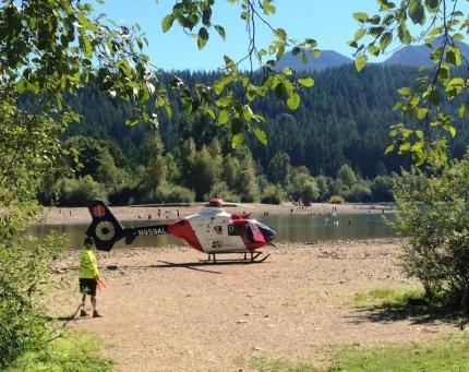 Emergency helicopter transportation at Rattlesnake Lake.