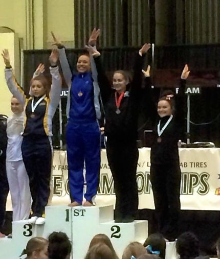 Jenn Rodgers, far right, finished 4th in the State 4A All-Around Gymnastics Final.