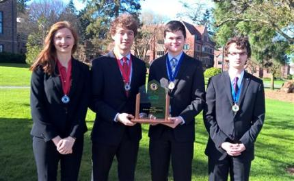 Dana Korssjoen and Ruary Thompson, Kevin Pusich and Ryan Hartman (left to right) after State Debate Finals.