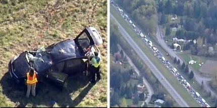 Kiro TV helicopter over the accident scene capture photo of the damaged passenger vehicle and ensuing back up from the hit and run investigation, 4/6/15