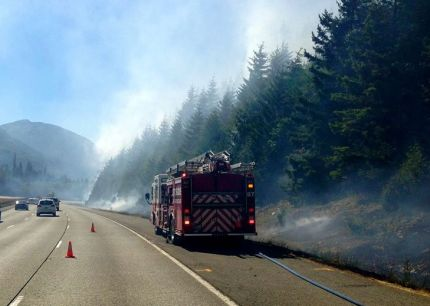 EF&R battle brush fire along I-90 in summer of 2013.