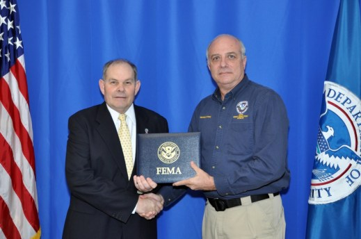 Emmitsburg, MD   March 20, 2014--FEMA's Emergency Management Institute (EMI) George O. Navarini completed all requirements of the National Emergency Management Academy.  Edward Smith, Acting Deputy Superintendent, EMI, is shown congratulating Mr. Navarini as he graduates.