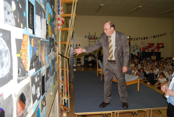 Apollo 14 Astronaut Dr Edgar Mitchell inspects paintings that children from a local school had done especially for him Image (©) Rick Mulheirn
