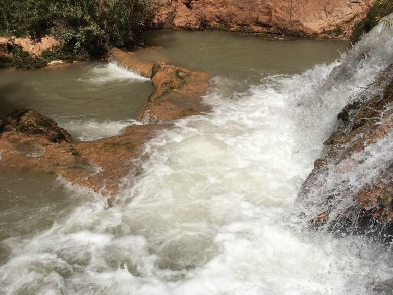 Rushing water along a rocky trail
