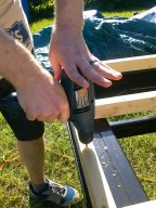 "After placing & clamping the frame, we drilled 1/4"" holes down through the wood & steel."