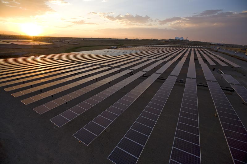 Sunset over ground solar array. (Credit: National Renewable Energy Laboratory for the Department of Energy, used as permitted.)