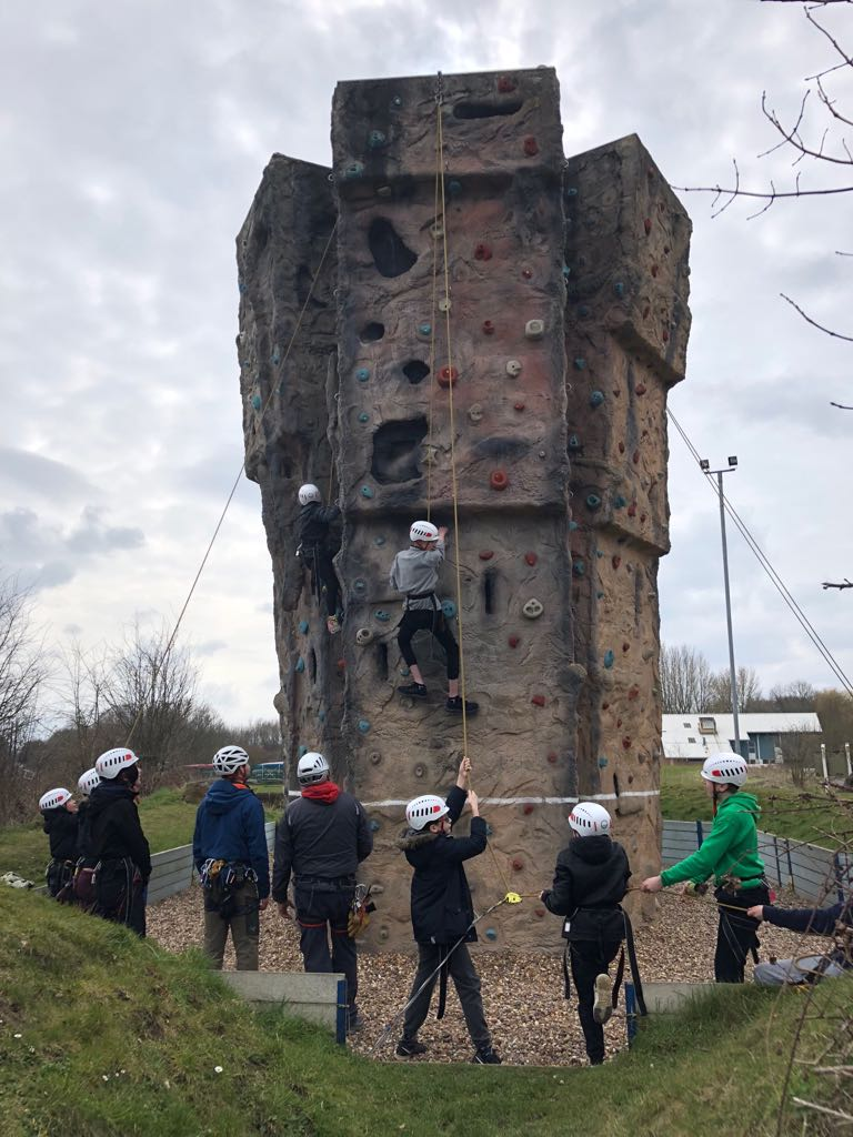 Children and young people rock climbing