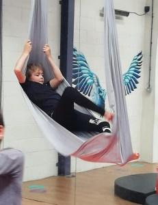 Young boy in yoga swing