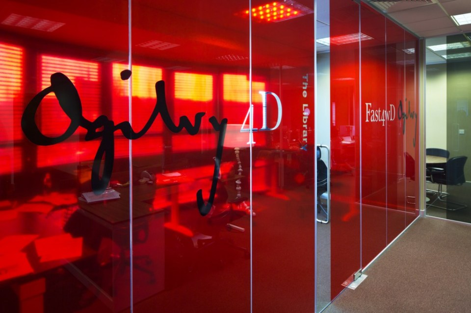 Image of Ogilvy 4D glass partitions with opaque branding decal graphics