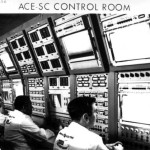 GE Employees Monitor Activities of a Spacecraft Test