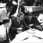 Carr, Slayton, Armstrong (seated), Schmitt & Aldrin (standing) compare Lunar Orbiter photos with Apollo 8 TV pics