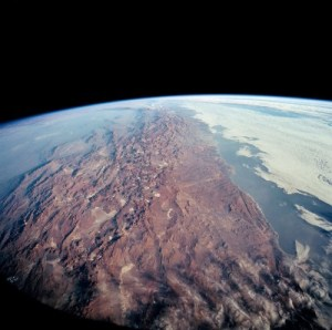 Panoramic view of the Andes mountain chain, running along the horizon of the Earth from top to bottom of this image - as captured by a NASA satellite.