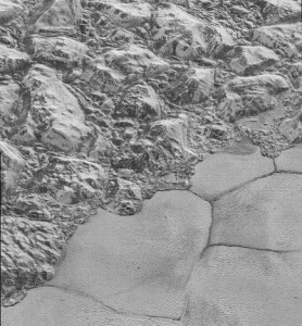 Mountains of grey jagged nitrogen ice float on polygonal dunes of methane and carbon dioxide on Pluto.