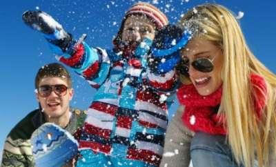 Winter season. Happy family having fun on fresh snow on vacation.