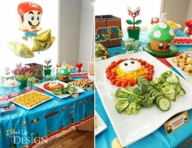 Fun party foods decorate this Mario Brothers table. Delicious party food doesn't have to be unhealthy.