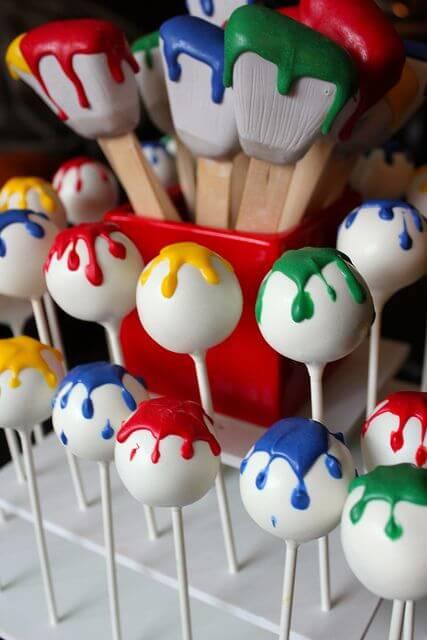 Paint brush and paint splatter cake pops