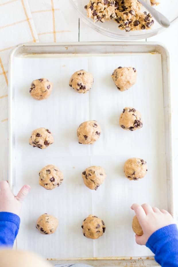 cookie batter rolled into balls on cookie sheet