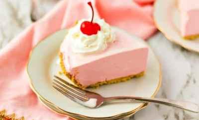 Slice of strawberry jello pie on a white plate