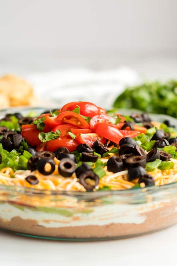 close up of toppings on seven layer dip