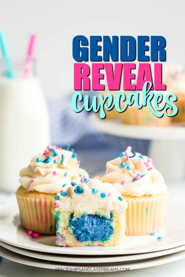 plate with three gender reveal cupcakes on it