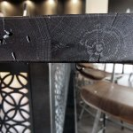 Detail of the vintage wood, treated with an ebony stain.