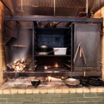View of the hearth. SPACE designed and fabricated the steel insert from pictures of traditional Mexican hearths.
