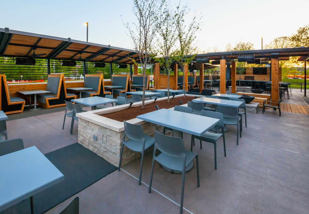 The patio features both ipe and cedar woods, and the concrete has two different colors to differentiate between seating areas.