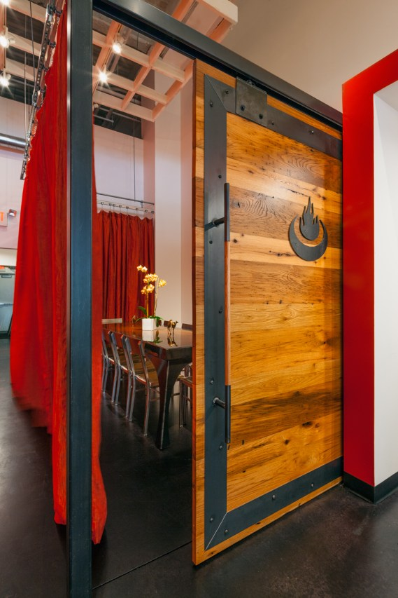 SPACE designed and built sliding wood door to the private dining room.