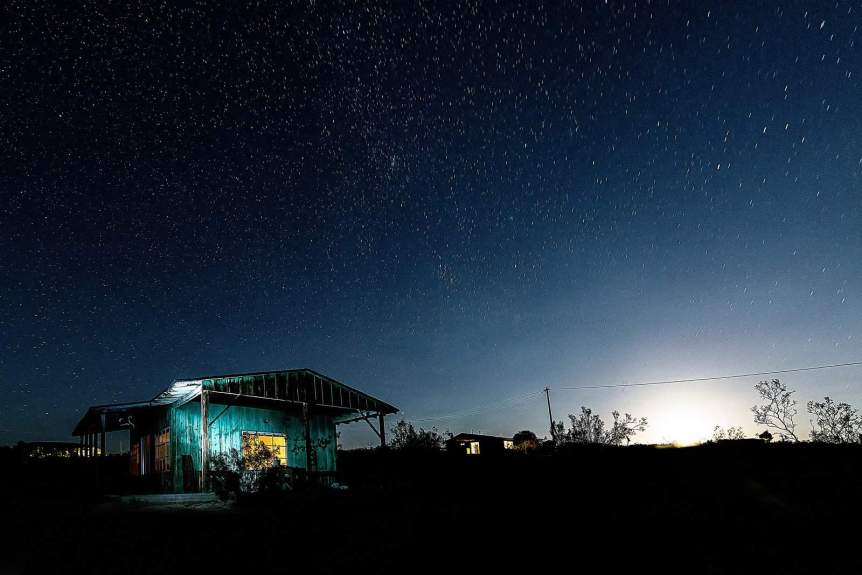 Where to Stay Near Joshua Tree National Park - Photo of House at Night by Christopher Michel via Wikimedia Commons