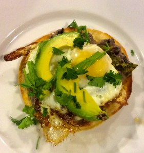 Tostada with beans and fried egg