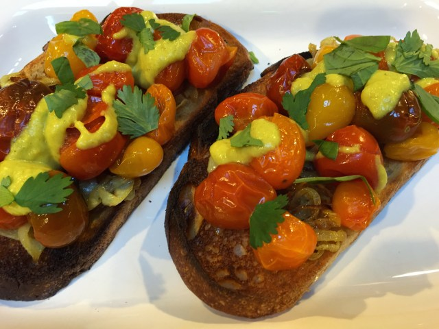 Cherry tomato bruschetta with carmelized onions and curry sauce