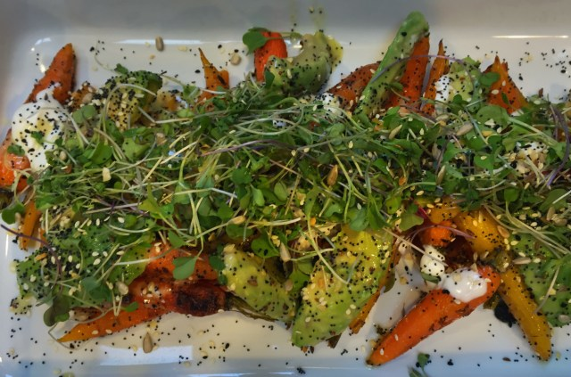 Roast Carrots with Avocado, microgreens sour cream and seedy mix