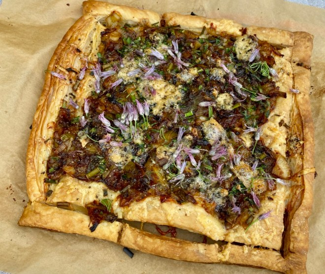 Puff Pastry Pizza with Caramelized Onions and Sliced Zucchini Flowers and Blue Cheese