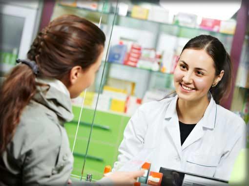 employee benefits photo showing woman talking to pharmacist