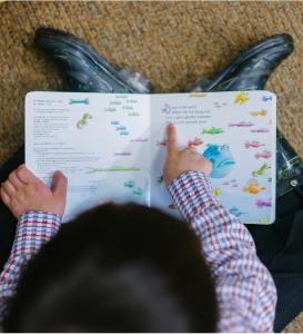 small child reading