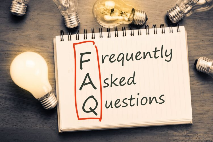 "Writing pad with text ""Frequently Asked Questions"" with first letters circled to display the abbreviation FAQ"