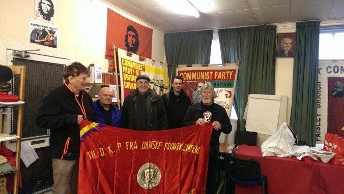 The party offices in Glasgow – Allan and Iain with the flag from the Danish volunteers in the Spanish Civil war to the Danish Communist Party, DKP – part of a photo reportage of the unveiling of the monument 'Blockade-Runners to Spain' in Glasgow, 2. March 2019