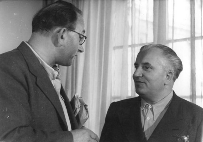 Jan Petersen and Willi Bredel talking at a German writer congress in Berlin: the Cultural League for Democratic Renewal of Germany, 4-6 July 1950.