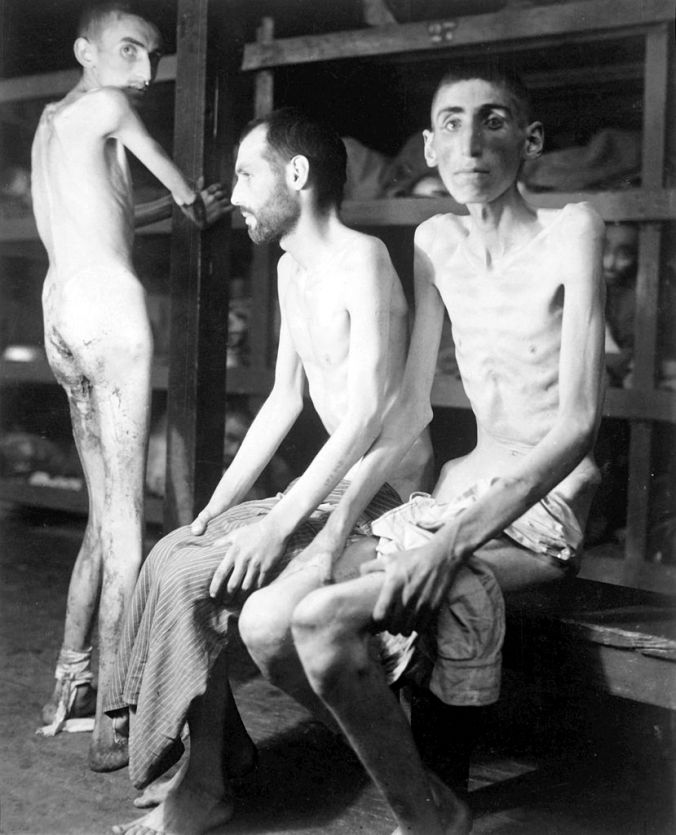 """The Kloostra Family and In-laws: Reinder Kloostra: Buchenwald prisoners, 16 April 1945: Original caption: """"These Russian, Polish, and Dutch slave laborers interned at the Buchenwald concentration camp averaged 160 pounds each prior to entering camp 11 months ago. Their average weight is now 70 pounds. Germany, 04/16/1945."""""""