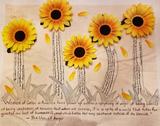 Tamia's One Pager shows artificial yellow daisies sprouting from handwritten text in a garden.