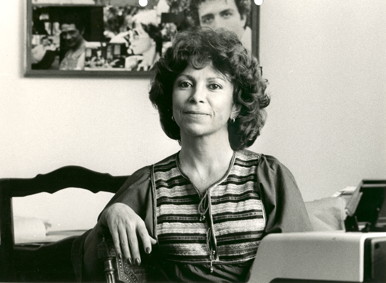 Isabel Allende at her typewriter, wearing a kaftan