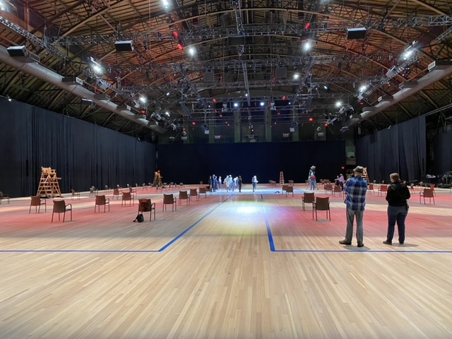 As the audience arrived, they were led to widely spaced chairs on the floor of the Armory. Photo courtesy Bjorn Amelan