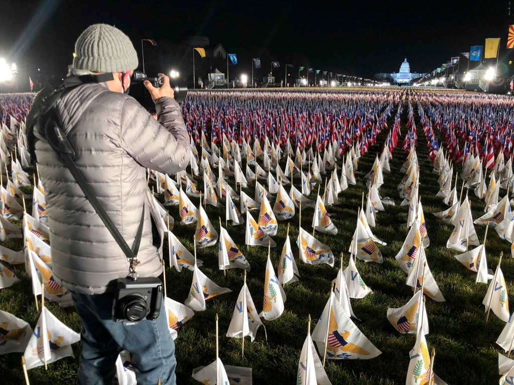 Stephen Wilkes taking an image from the ground at the 2021 Inauguration, across the field of flags. Photo courtesy of the Stephen Wilkes team.