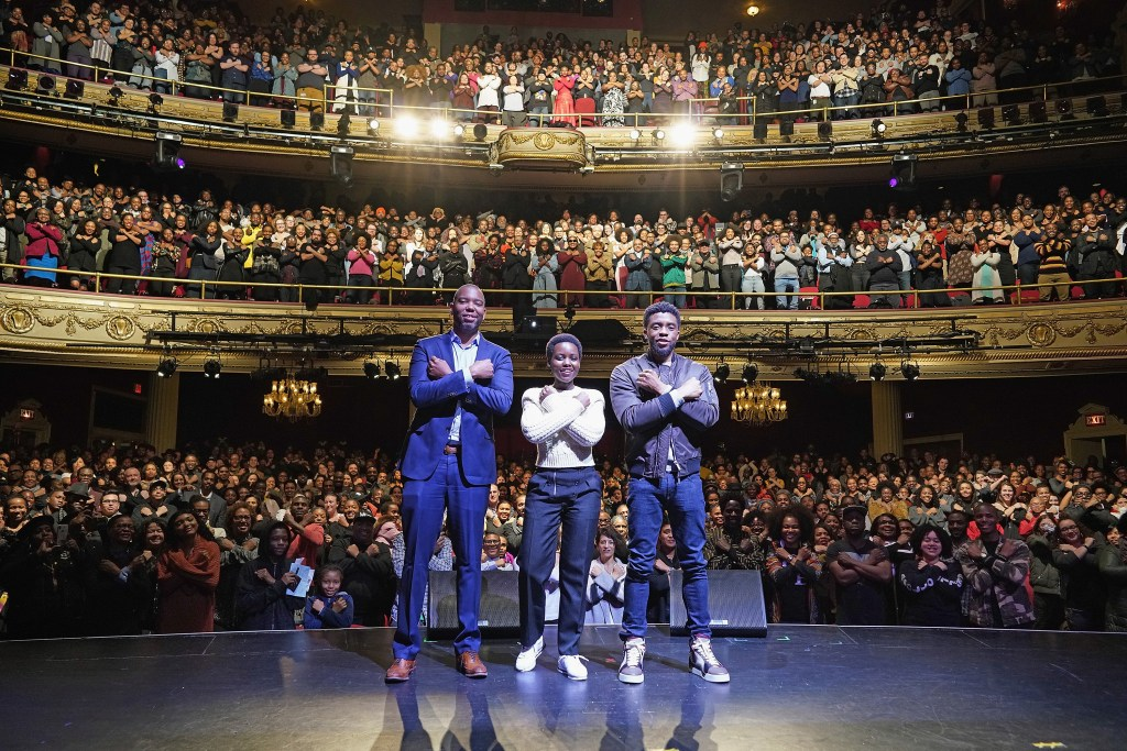 Author Ta-Nehisi Coates with Black Panther stars Chadwick Boseman and Lupita Nyong'o at The Apollo Theater on February 27, 2018 in New York City. Photo by Shahar Azran/WireImage