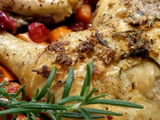 Need an elegant dinner that's simply delicious and easy? We have got just the dish for you, our recipe for Rosemary Chicken Over Cranberries & Carrots!