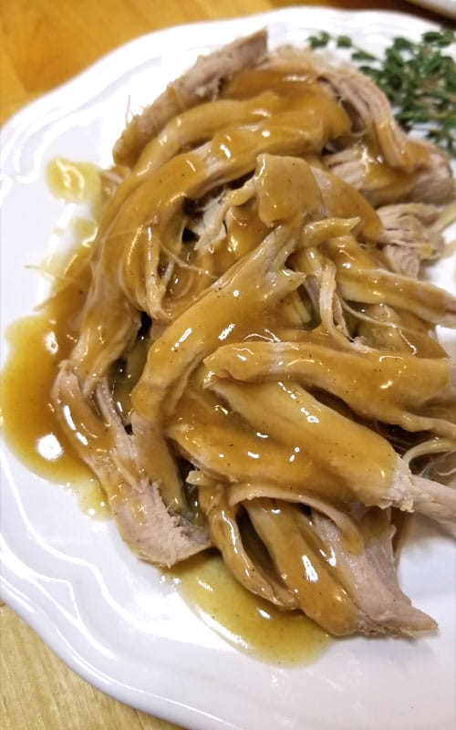 This Trisha Yearwood's Crock Pot Pork Tenderloin is so tender and SO tasty! What set this recipe above the others was the gravy!!!  It is over the moon good!